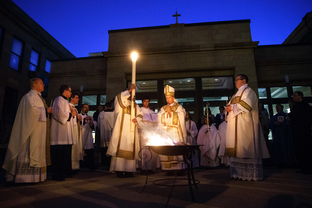 Bishop Thomas John Paprocki conducts the Blessing of the New Fire and Lighting of the Pascal Candle during the Easter Vigil at the Cathedral of the Immaculate Conception in Springfield, Ill. Saturday, April 4, 2015. This week marks the observance of two significant events in the Jewish and Christian calendars - Passover, the Jewish commemoration of the Hebrews exodus from slavery in Egypt, and Easter, the Christian celebration of Jesus' resurrection from the dead after his crucifixion. Ted Schurter/The State Journal-Register