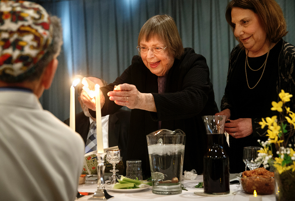 Judy Foster lights two candles during the Community Passover Seder at Temple B'rith Sholom Saturday, April 4, 2015. Nancy Sage is at right. Ted Schurter/The State Journal-Register