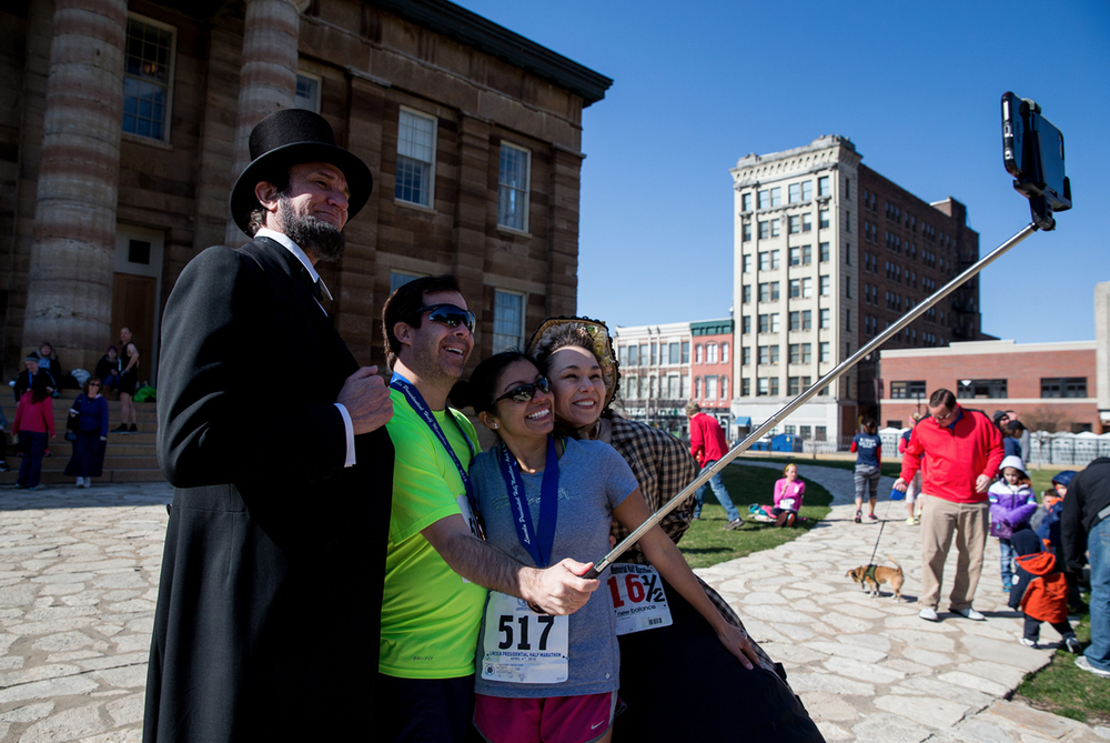 John Fowler and his wife, Ada, use a selfie stick to take a picture with Michael Krebs as Abraham Lincoln and Debra Miller as Mary Todd Lincoln after finishing the 2015 Lincoln Presidential Half Marathon, Saturday, April 4, 2015, in Springfield, Ill. Justin L. Fowler/The State Journal-Register