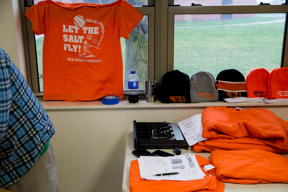 "Commemorative t-shirts with the slogan ""Let the salt fly!"" were on sale for game between the New Berlin Pretzels and the Freeport Pretzels at New Berlin High School, Tuesday, April 7, 2015, in New Berlin, Ill. Justin L. Fowler/The State Journal-Register"