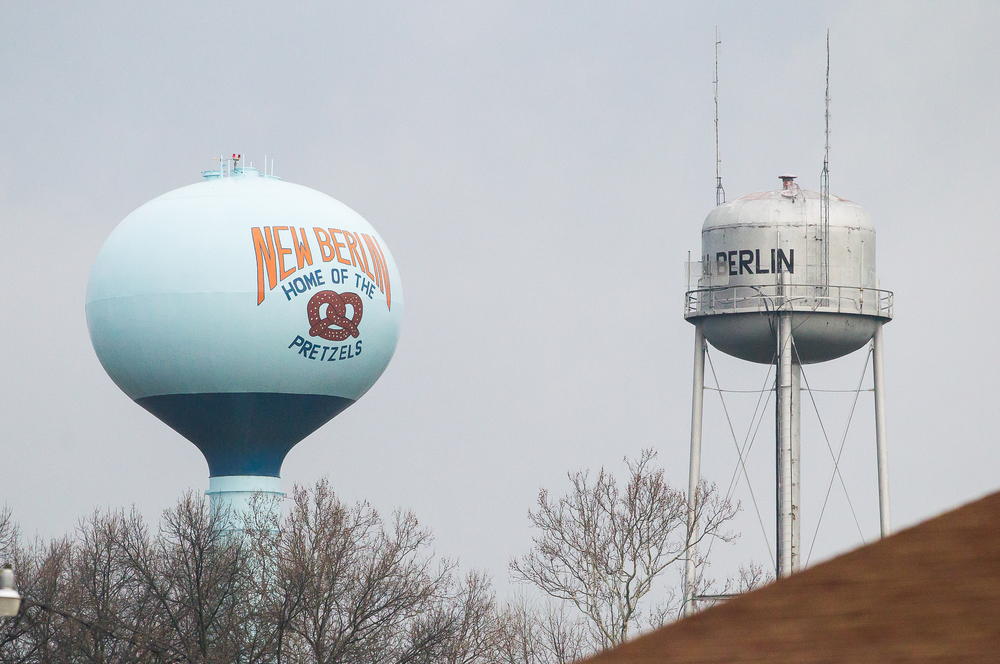 "The water tower in New Berlin with the painted slogan of ""Home of the Pretzels"" is viewable from the high school at the baseball field as the New Berlin Pretzels take on the Freeport Pretzels at New Berlin High School. Justin L. Fowler/The State Journal-Register"