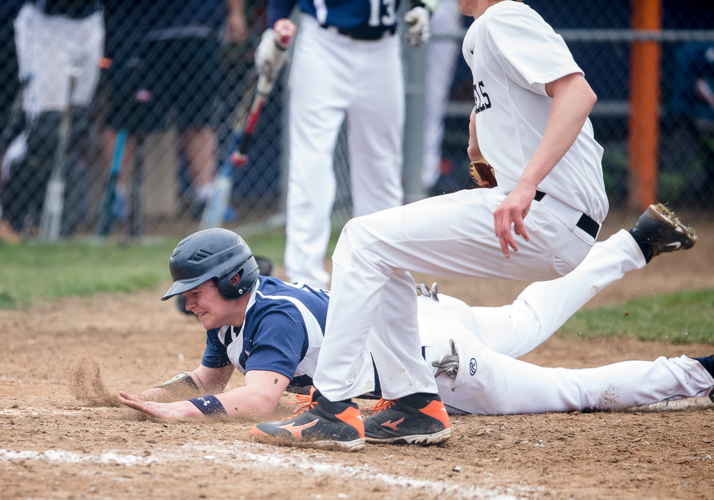 New Berlin's Matt Miller slides safely into home avoiding the tag from the Freeport Pretzels at New Berlin High School, Tuesday, April 7, 2015, in New Berlin, Ill. Justin L. Fowler/The State Journal-Register