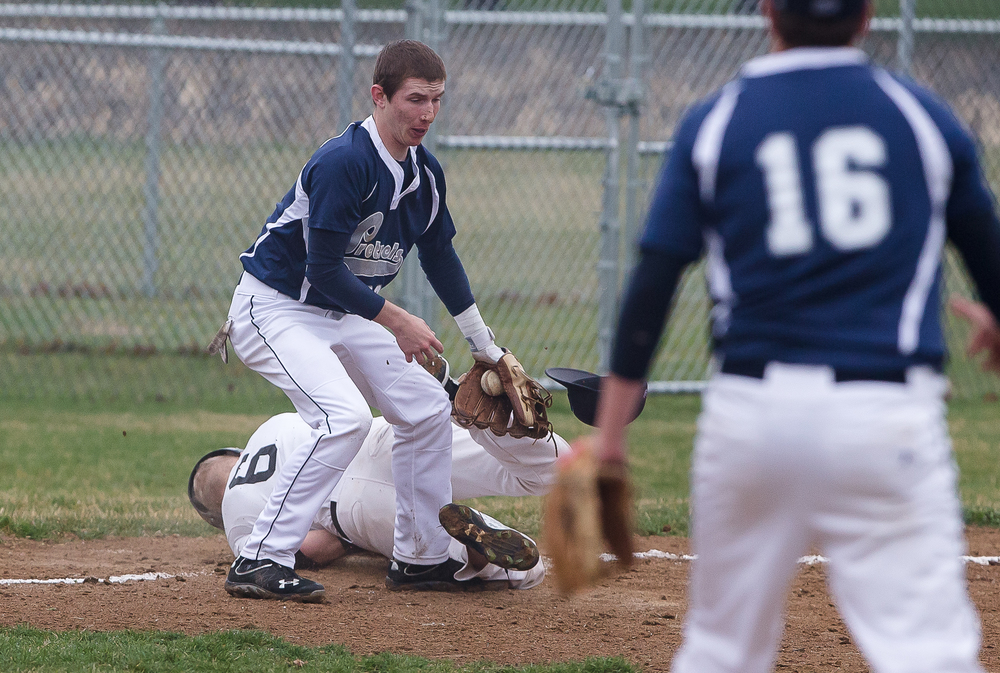 New Berlin third baseman Josh Fuchs reacts after taking a cleat to the face as Freeport's Andrew Woods slides into third base at New Berlin High School, Tuesday, April 7, 2015, in New Berlin, Ill. Justin L. Fowler/The State Journal-Register