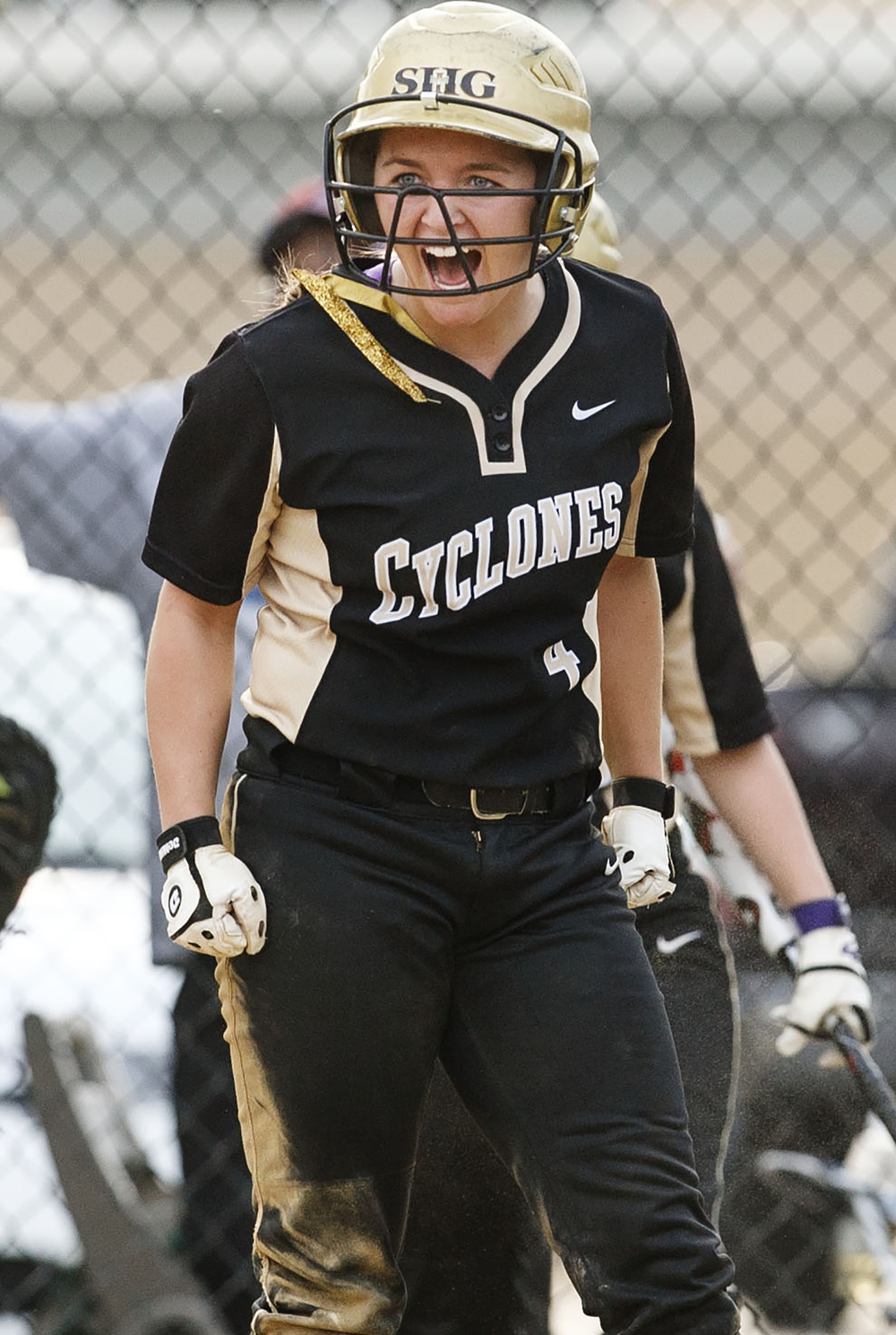 Sacred Heart-Griffin's Katie McLean lets out at yell after scoring in the 5th inning against Chatham Glenwood at Sacred Heart-Griffin West Wednesday April 8, 2015. Ted Schurter/The State Journal-Register