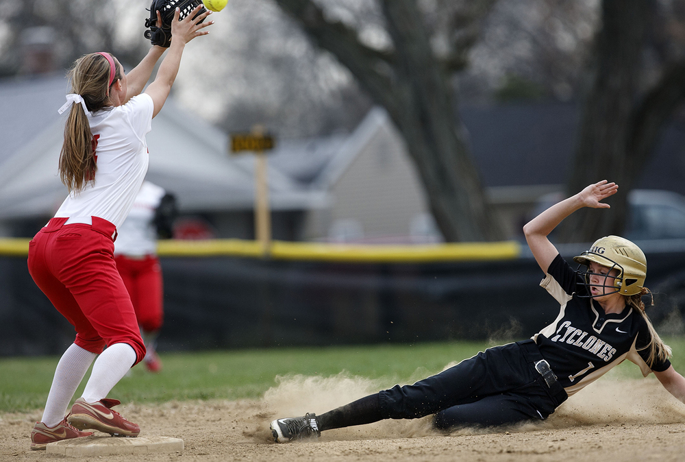 Chatham Glenwood's Parker Bandy makes a catch at second base as Sacred Heart-Griffin's Lexie Kuchar slides in at Sacred Heart-Griffin West Wednesday April 8, 2015. Kuchar was deemed safe, sparking a conversation on the field between Glenwood head coach Vondel Edgar and game officials. Ted Schurter/The State Journal-Register
