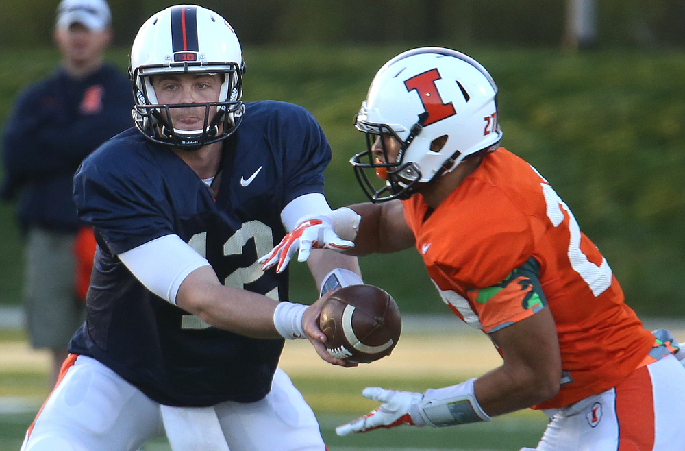 Illini quarterback Wes Lunt passes the ball to receiver Eaton Spence. David Spencer/The State Journal Register