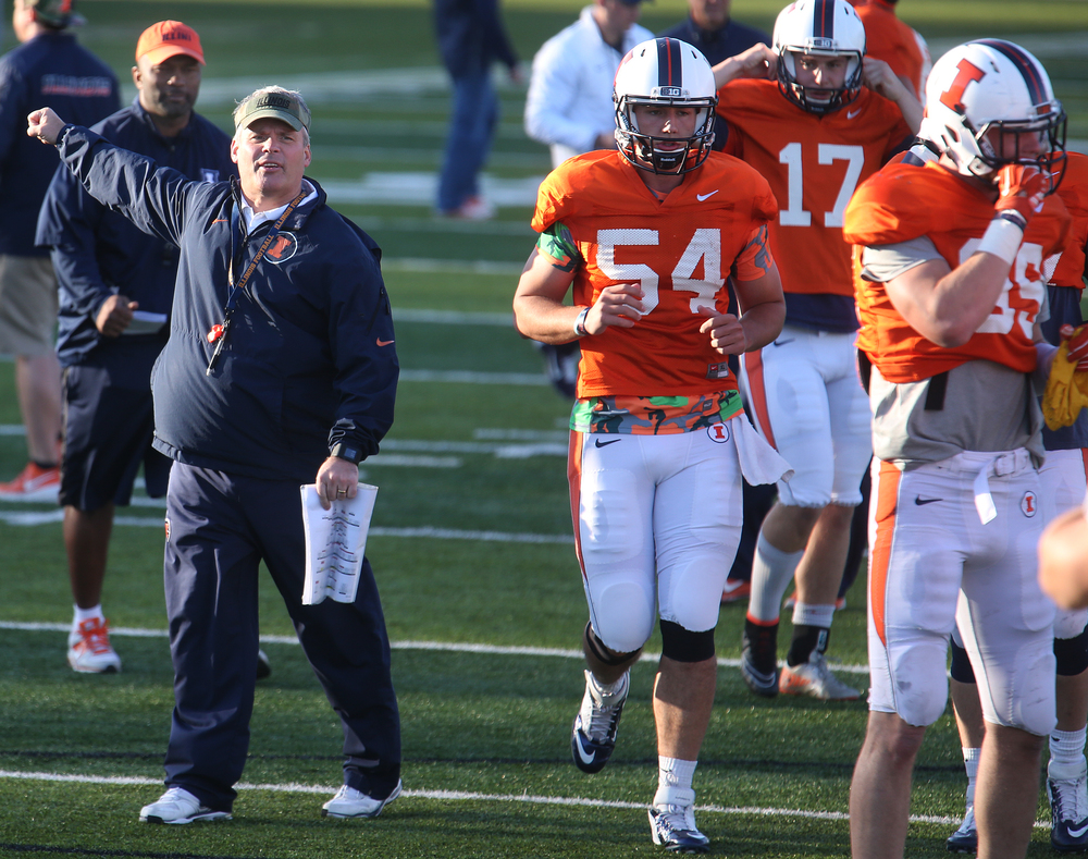 Illini head coach Tim Beckman directs his players during the scrimmage. David Spencer/The State Journal Register