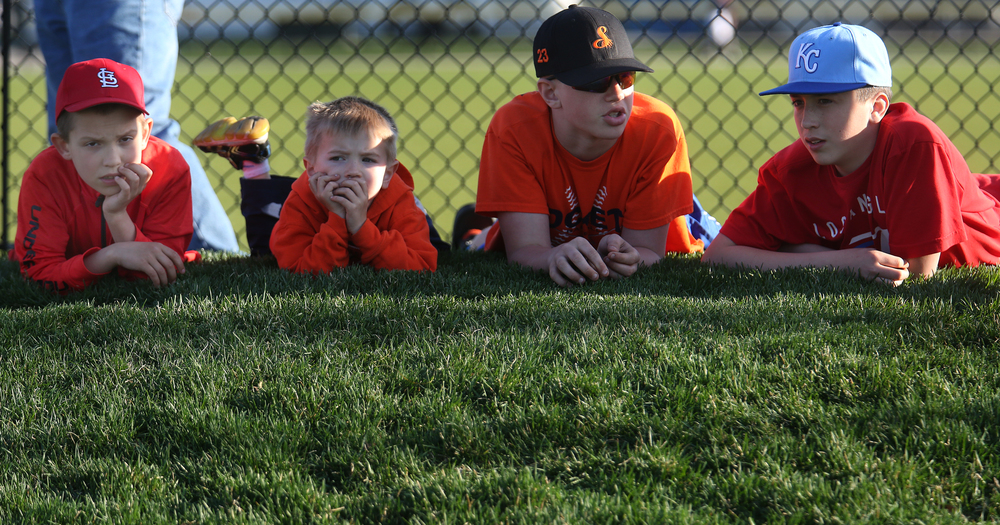 Children wait in the south end-zone for the scrimmage to begin. David Spencer/The State Journal Register