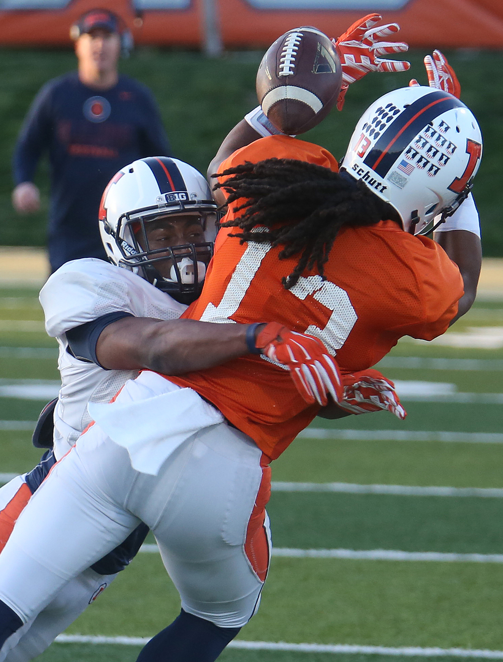 The Illini's Eaton Spence breaks up a pass intended for receiver Dionte Taylor. David Spencer/The State Journal Register