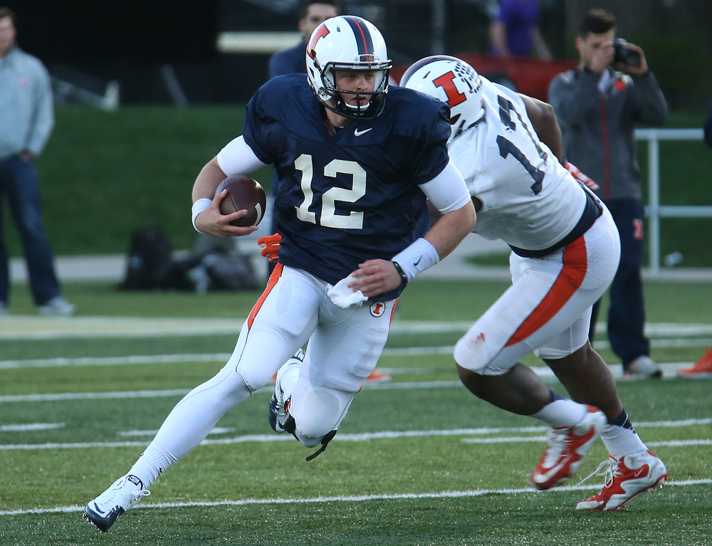 Illini quarterback Wes Lunt evades Jihad Ward while running the ball. David Spencer/The State Journal Register