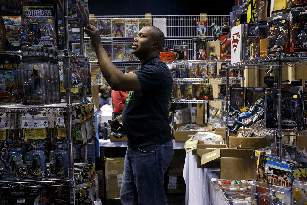 Joe Harper looks through the merchandise for sale during the official G.I. Joe Collectors' Convention at the Prairie Capital Convention Center Saturday, April 11, 2015.  Ted Schurter/The State Journal-Register
