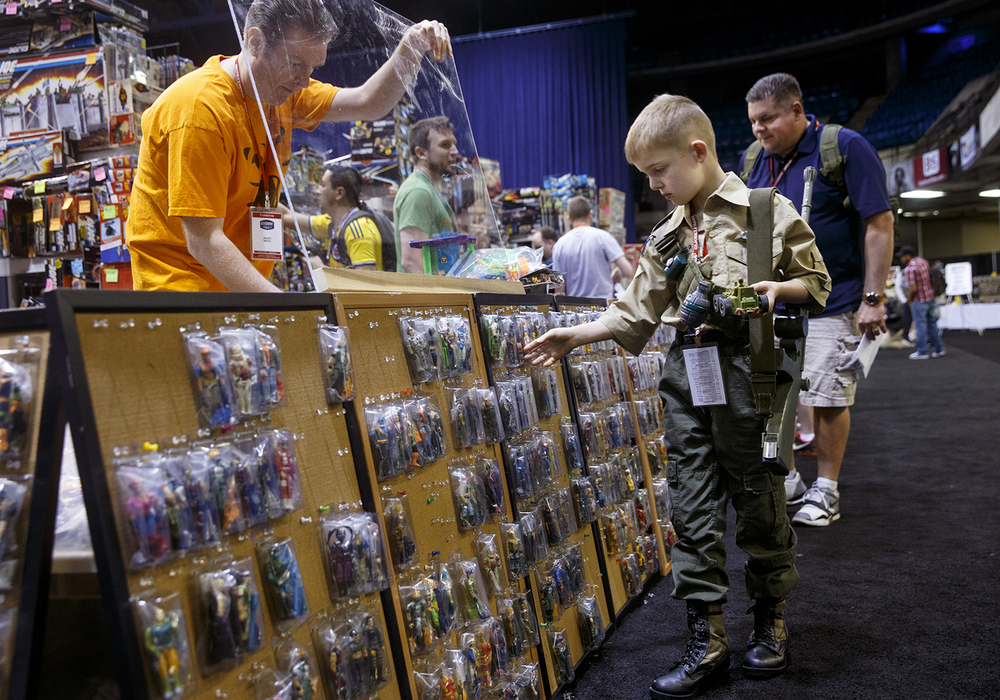 Zachary White browses the action figures available for sale during the official G.I. Joe Collectors' Convention at the Prairie Capital Convention Center Saturday, April 11, 2015.  Ted Schurter/The State Journal-Register