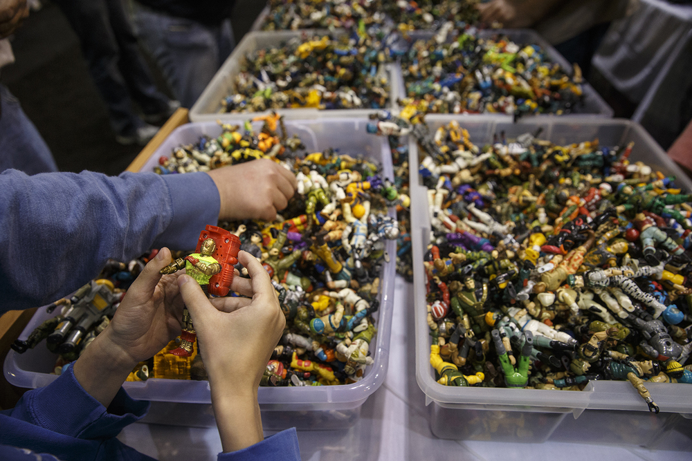 Guests sort through assorted action figures for sale during the official G.I. Joe Collectors' Convention at the Prairie Capital Convention Center Saturday, April 11, 2015.  Ted Schurter/The State Journal-Register