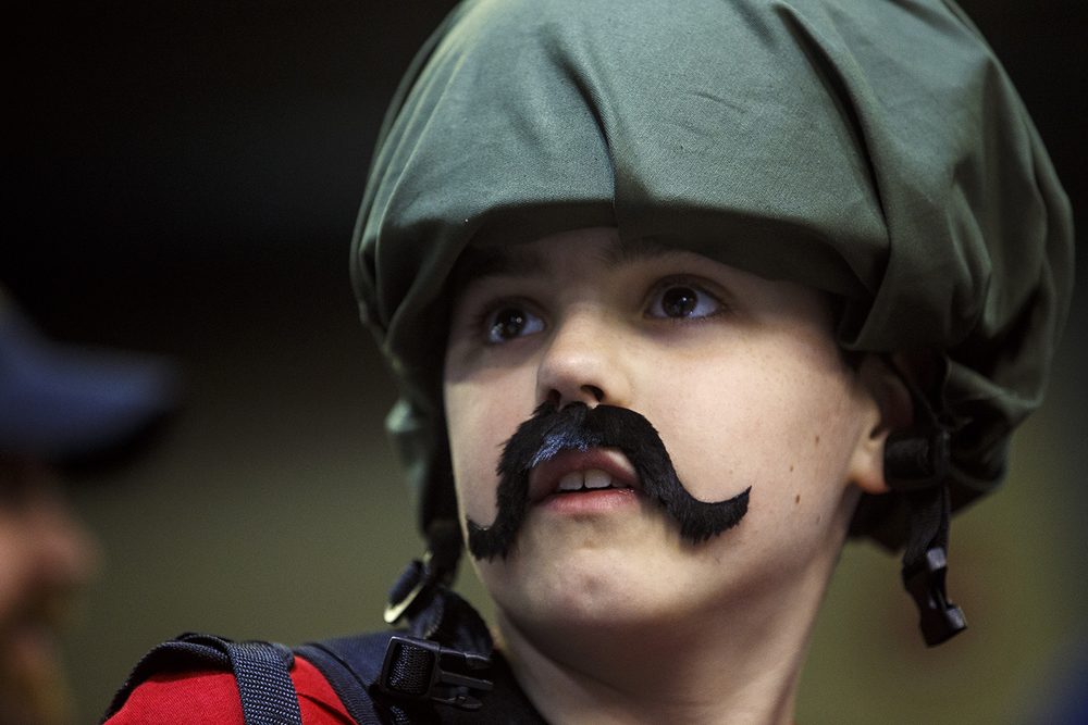 Colton Knaebel sports a costume mustache to go along with his Bazooka character costume during the official G.I. Joe Collectors' Convention at the Prairie Capital Convention Center Saturday, April 11, 2015.  Ted Schurter/The State Journal-Register