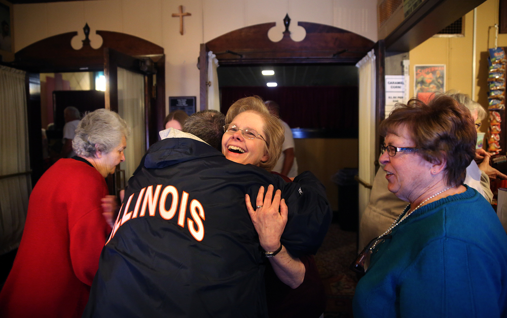 Gaye Maxson hugs an old friend who came to the re-opening on Saturday: Steve Stilts. At right is Stilts sister Jan Durre. At far left is Phyllis Hofmann, who said she had been coming to the Arlee since the 1950's. David Spencer/The State Journal-Register
