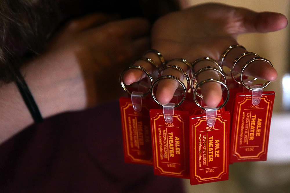 A close-up of the Arlee Theater keychains: 1936-2015, being handed out by employee Autumn Saferite, 15, inside the theater. David Spencer/The State Journal-Register
