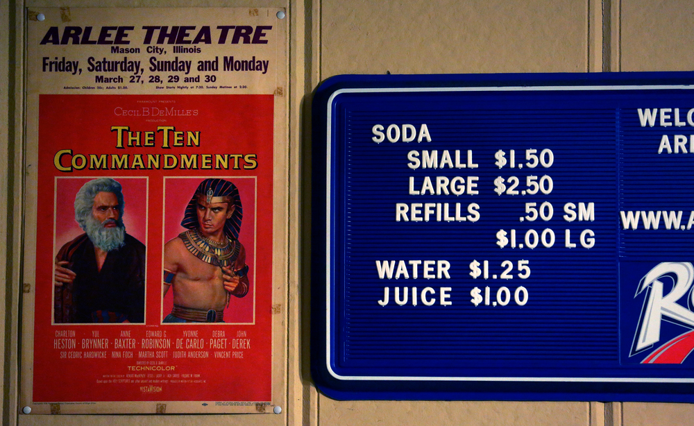 An original lobby card from Cecil B. DeMille's The Ten Commandments released in 1956 hangs alonside a sign for drinks behind the concession area.  David Spencer/The State Journal-Register