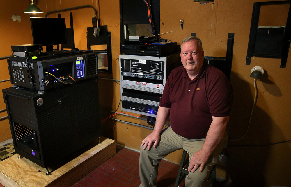 In the projection room, John Maxson sits next to the new state-of-the-art digital projector paid for by community members. David Spencer/The State Journal-Register