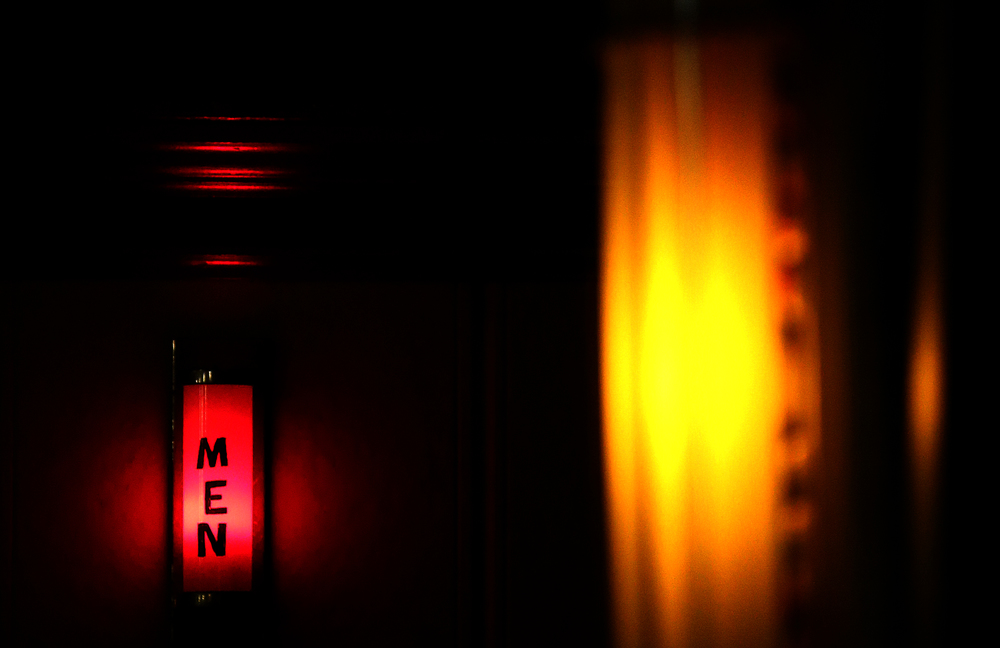 Original Art-Deco lighting, including the Mens room sign made from red glass, glow on the inside of the theater in the rear of the auditorium. David Spencer/The State Journal-Register