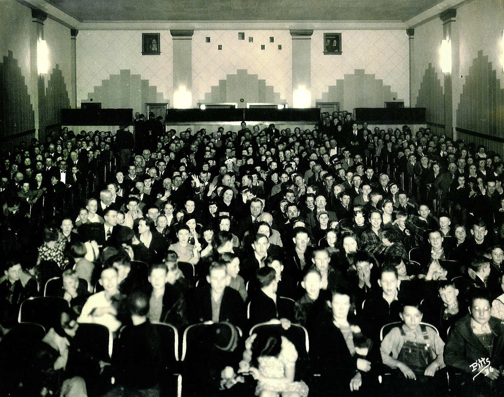 All 500 seats are filled with movie patrons on opening night in 1936 during the grand opening of the Arlee Theater. photo courtesy Gaye Maxson