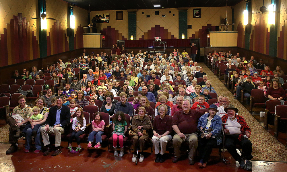 In a recreation of the old photo, nearly a full house put their smiles on for the relaunch of the Arlee before the start of the movie Saturday afternoon. David Spencer/The State Journal-Register