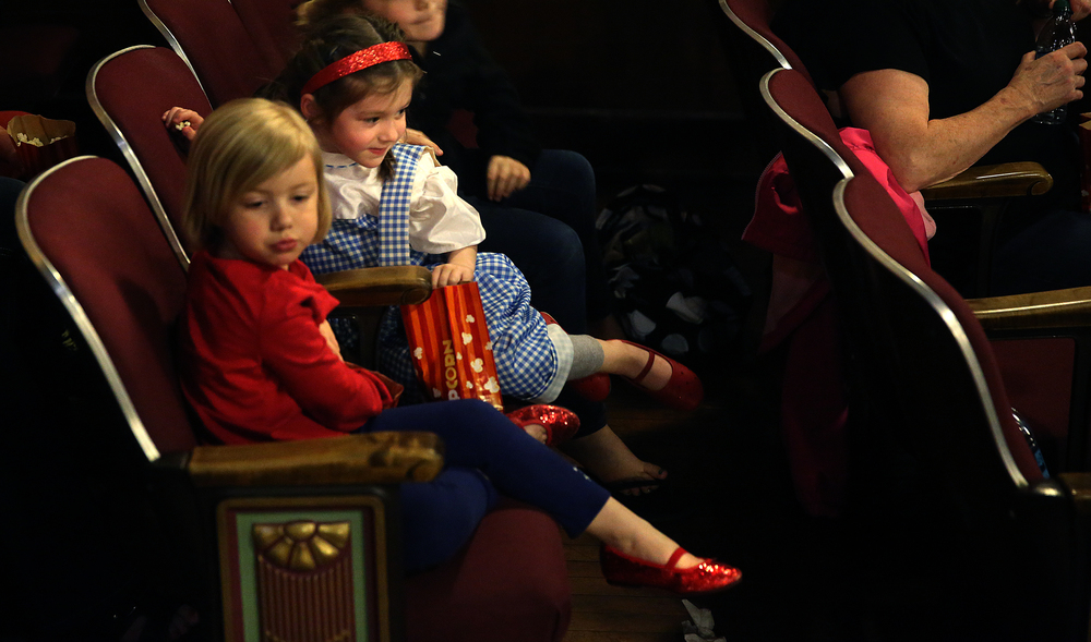 "More than one little girl attending wore ruby red slippers in honor of Dorothy from ""The Wizard of Oz"" seen here before the house lights went down. David Spencer/The State Journal-Register"