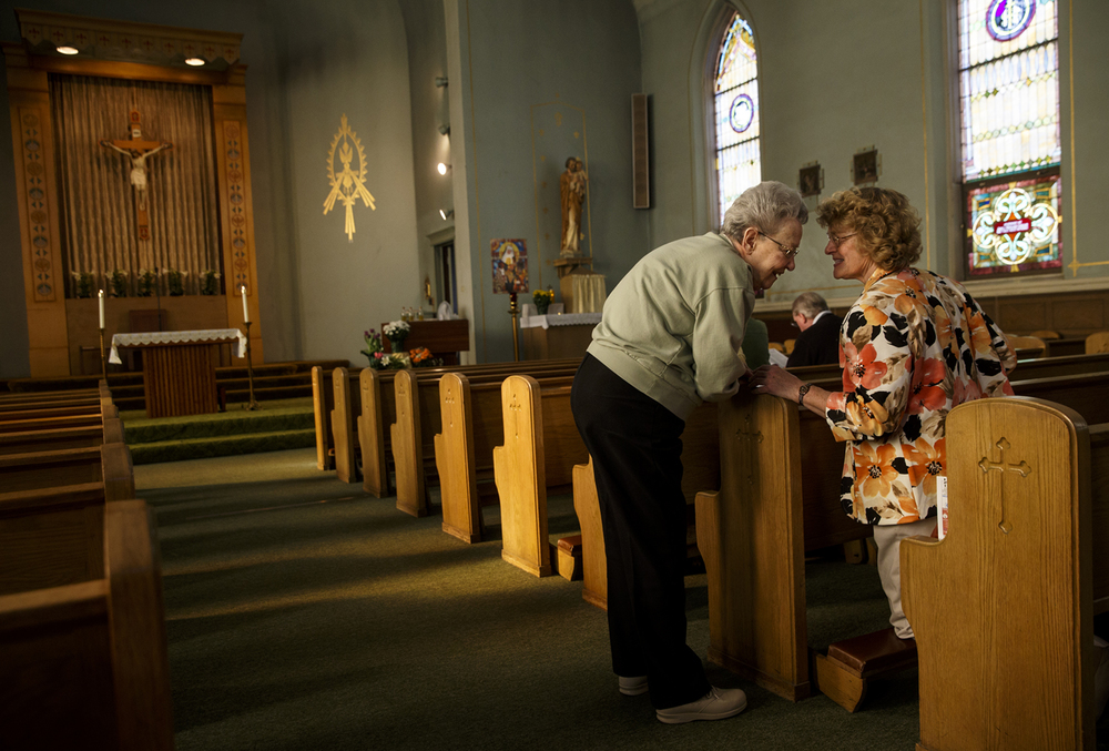 Marcella McKennedy, left, visits with Linda Lawrence before the start of Mass at St. Patrick's Church Sunday, April 5, 2015. Three priests from the Canons Regular of St. John Cantius in Chicago will begin leading St. Katherine Drexel parish, which includes St.Pat's and Sacred Heart Church, this summer. Ted Schurter/The State Journal-Register