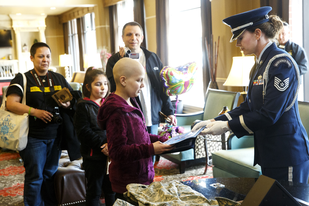 "Emily Beazley receives a copy of the Airman's Creed  from Illinois Air National Guard Tech. Sgt. Samantha Diskey at the Abraham Lincoln Hotel and Conference Center Tuesday, April 7, 2015. Beazley travelled with her sister Olivia and parents Ed and Nadia from Chicago as a ""Bear Necessities Pediatric Cancer Foundation"" and ""Make-a-Wish"" sponsored trip to visit the Illinois Policeman's Memorial and the Lincoln sites. She received a police escort from Riverton and was greeted at the hotel by a host of first responders and their vehicles and other well wishers. The family was then transported in the Springfield Police Department's BearCat armored response vehicle to the memorial. Beazley has Stage III T-Cell Lymphoblastic Non-Hodgkins Lymphoma, the most aggressive form of Non-Hodgkins Lymphoma. Ted Schurter/The State Journal-Register"