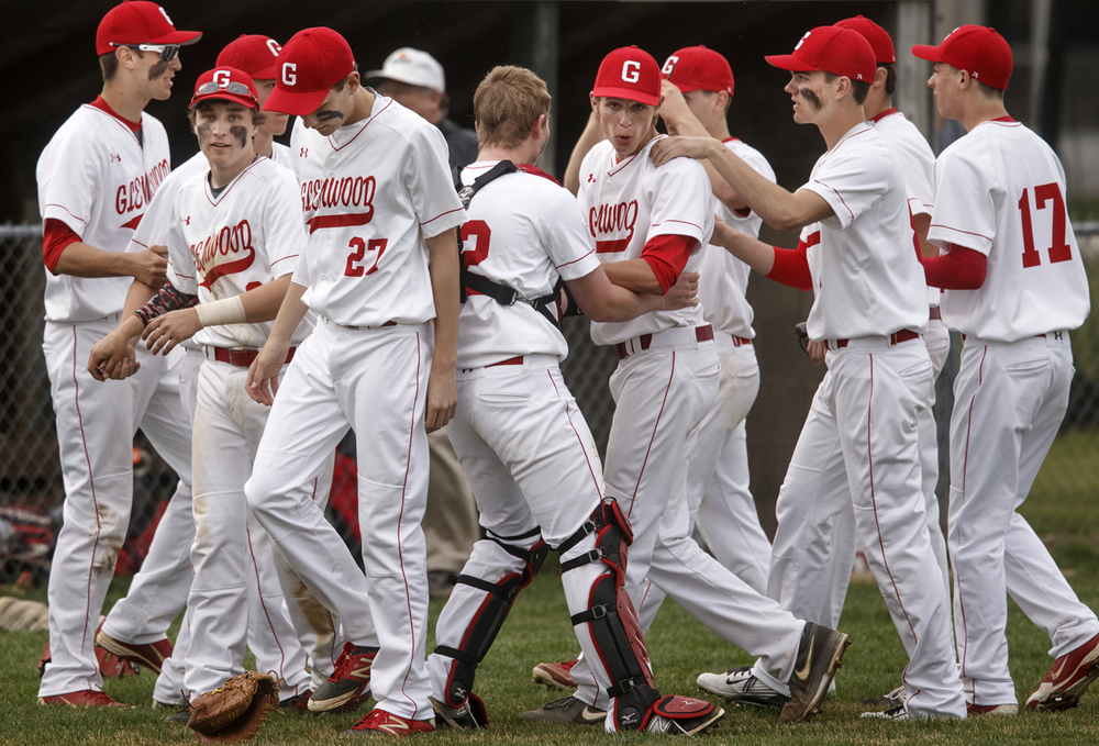 Chatham Glenwood pitcher Nick Maton celebrates with his teamates after getting the 2-1 win against Sacred Heart-Griffin Tuesday, April 7, 2015. Ted Schurter/The State Journal-Register
