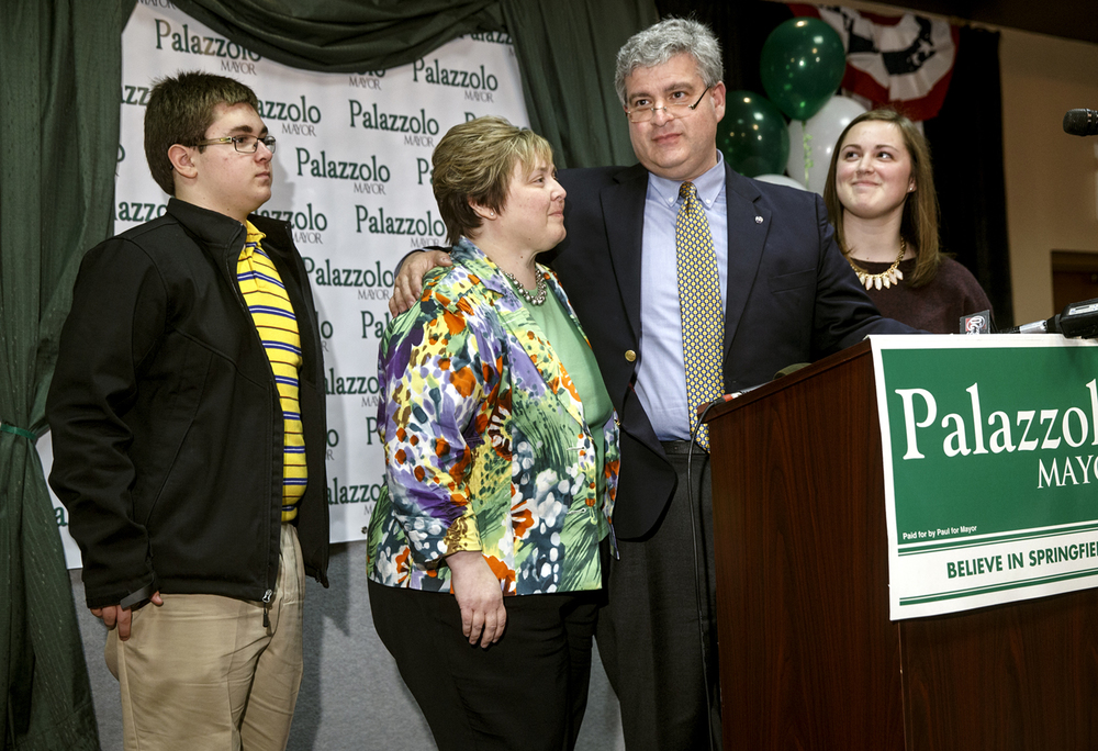 Surrounded by his son Anthony, wife Suanne and daughter Maria,  mayoral candidate Paul Palzzollo concedes to Jim Langfelder Tuesday, April 7, 2015.  Ted Schurter/The State Journal-Register