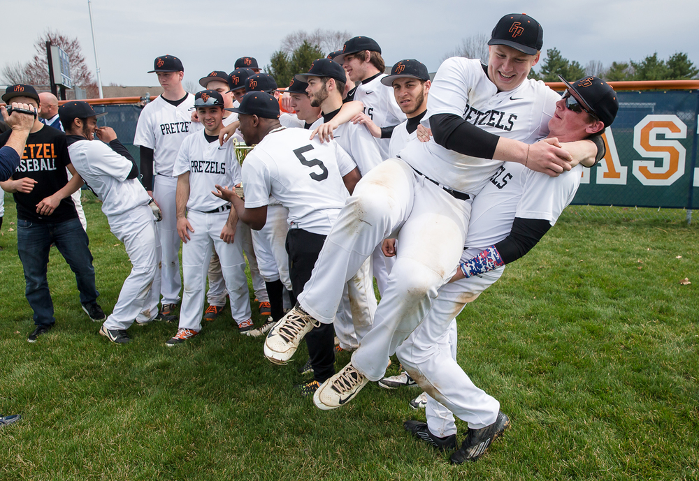 Freeport's Conor Greene hoists up his teammate Travis Buckwalter after the team celebrates defeating the New Berlin Pretzels 10-4 at New Berlin High School, Tuesday, April 7, 2015, in New Berlin, Ill. Justin L. Fowler/The State Journal-Register