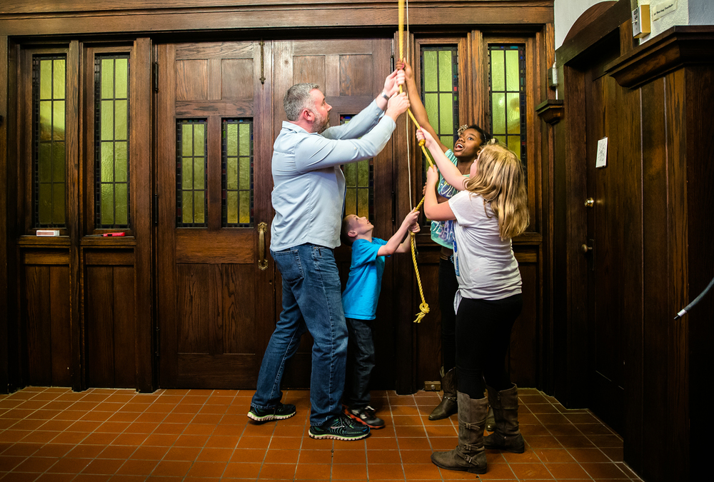 Seth Roderick, left, and his son, Quinn, 6, along with Susannah Roderick, 12, center, and Taylor Alfredson, 10, right, ring the bell of the Cathedral Church of St. Paul as they help mark the 150th anniversary of Confederate Gen. Robert E. Lee's surrender, Thursday, April 9, 2015, in Springfield, Ill. The bell ringing was in conjunction with the National Park Service that asked that bells be rung across the country after a ceremonial ringing at Appomattox Court House National Historical Park for the anniversary of Lee's surrender on April 9, 1865 ending the American Civil War. Justin L. Fowler/The State Journal-Register