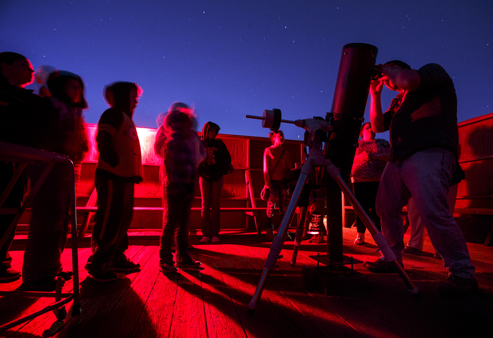A line forms at one of the telescopes on the roof of Brookens Library for the first Star Party of the season at the University of Illinois Springfield Friday, April 10, 2015. Ted Schurter/The State Journal-Register