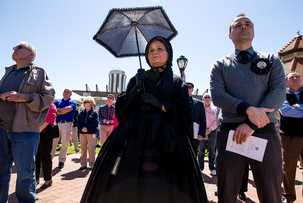 "Pam Brown, center, portrays Mary Todd Lincoln in mourning during the ""Abraham Lincoln: A Day of Remembrance"" event at Union Square Park, Wednesday, April 15, 2015, in Springfield, Ill. Justin L. Fowler/The State Journal-Register"