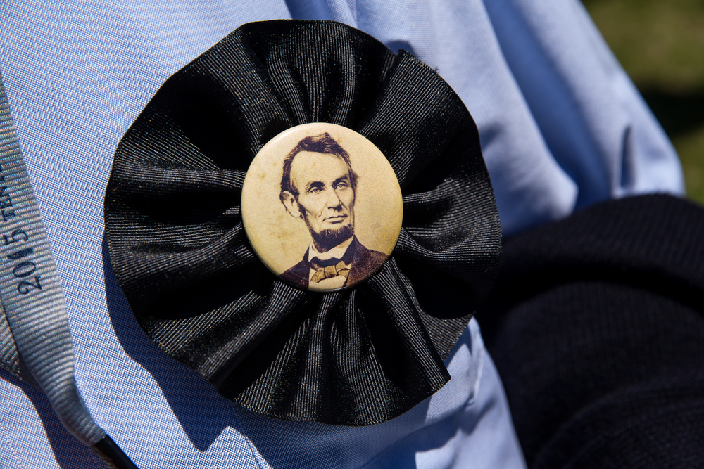 "Volunteers and staff of the Abraham Lincoln Presidential Museum and Library wore handmade Lincoln mourning pins during the ""Abraham Lincoln: A Day of Remembrance"" event at Union Square Park, Wednesday, April 15, 2015, in Springfield, Ill. Justin L. Fowler/The State Journal-Register"