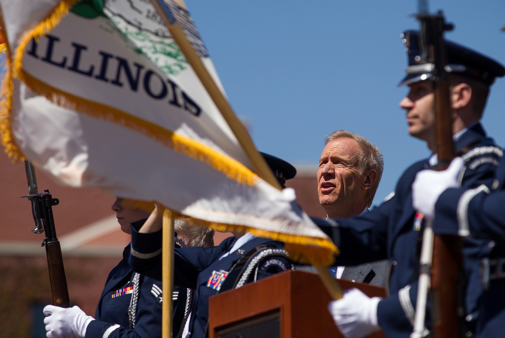 "Illinois Gov. Bruce Rauner sings along to the National Anthem performed by Jim Cornelison of the Chicago Blackhawks during the ""Abraham Lincoln: Day of Remembrance"" at Union Square Park, Wednesday, April 15, 2015, in Springfield, Ill. Justin L. Fowler/The State Journal-Register"