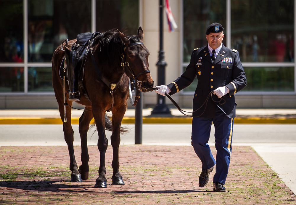 "Lt. Col. Mark Whitlock escorts Otis, a caparisoned horse with boots reversed in the stirrups, to the stage in honor of Abraham Lincoln during the ""Abraham Lincoln: A Day of Remembrance"" event at Union Square Park, Wednesday, April 15, 2015, in Springfield, Ill. Justin L. Fowler/The State Journal-Register"
