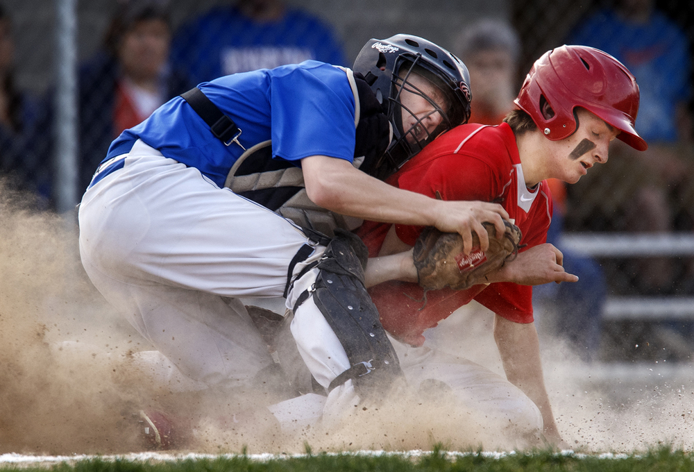 Riverton's Devin Zattich-Hillen tags  Pleasant Plains' Zach Ross out at home to end the sixth inning at the Riverton Athletic Club Thursday, April 16, 2015. Ted Schurter/The State Journal-Register