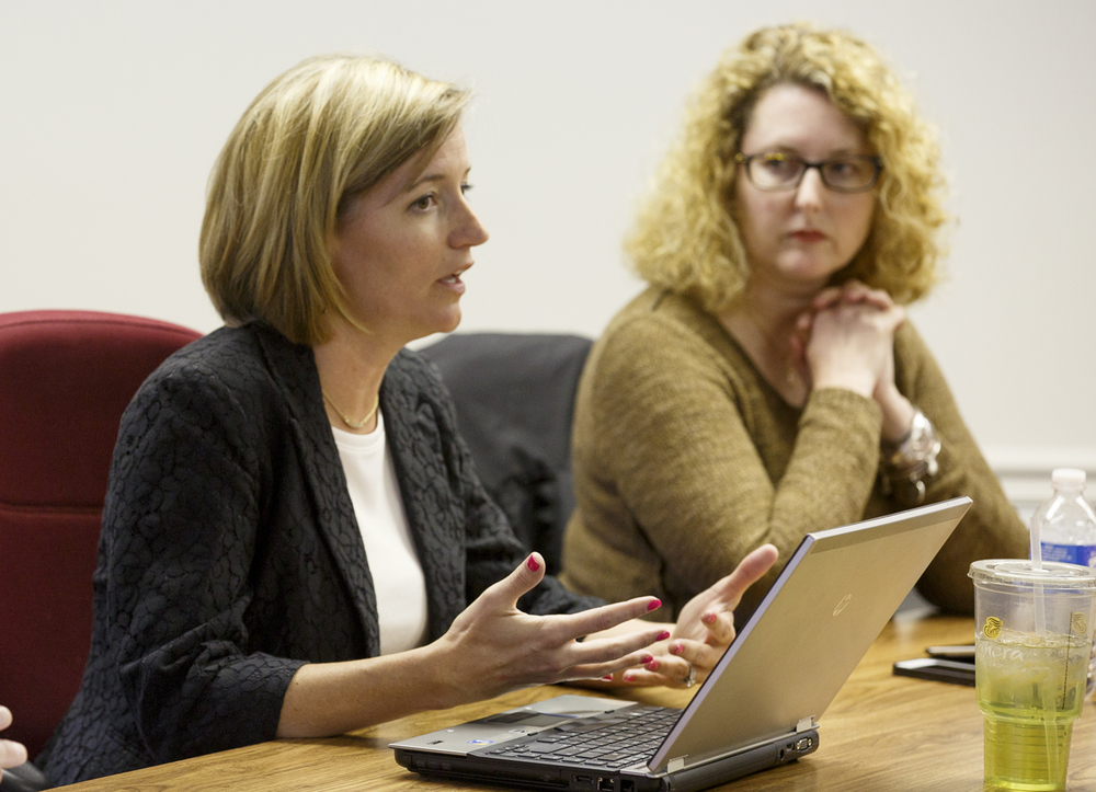 Chatham School Superintendent Carrie Hruby, left, presided over a special special school board meeting Monday, April 13, 2015 when the board voted to eliminate 18 teachers from the district due to state budget cuts. Board member Lisa Wentzel, right, was the only dissenting vote. Rich Saal/The State Journal-Register