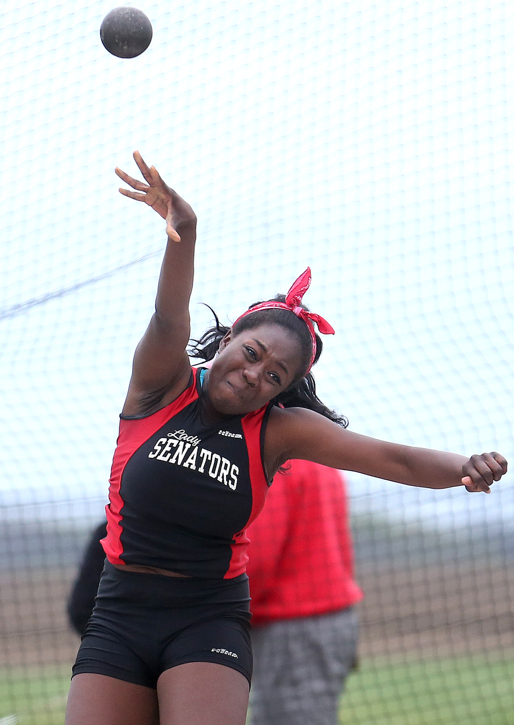 Springfield's A.J. Erewele shows off her form during the girls shot put event. David Spencer/The State Journal-Register
