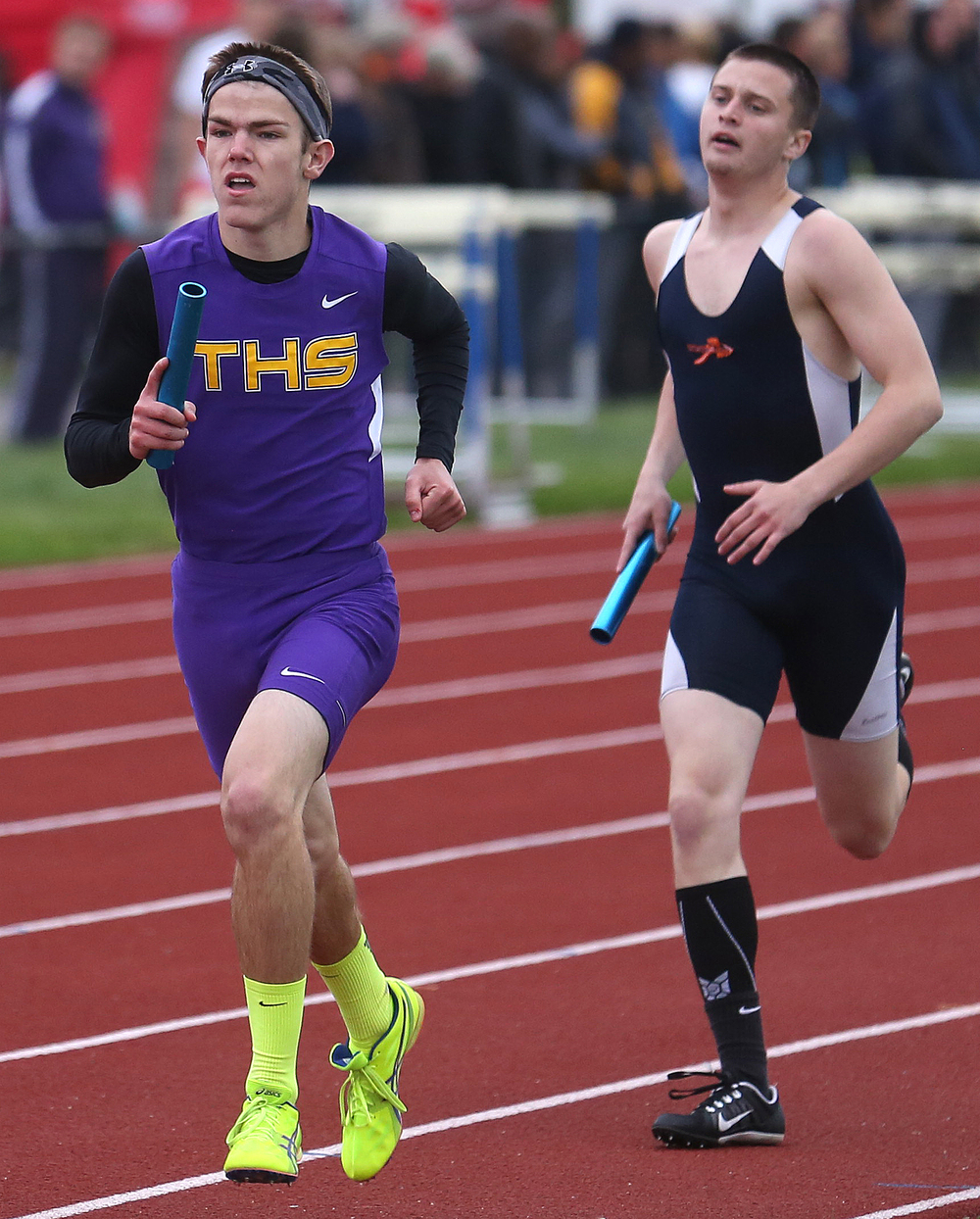 The boys 4 x 800 meter relay event was won by Taylorville. Here, Tommy O'Brien, in front of Pontiac's Alex Sennott, prepares to hand the baton to teammate Will Walton who ran the final leg. David Spencer/The State Journal-Register