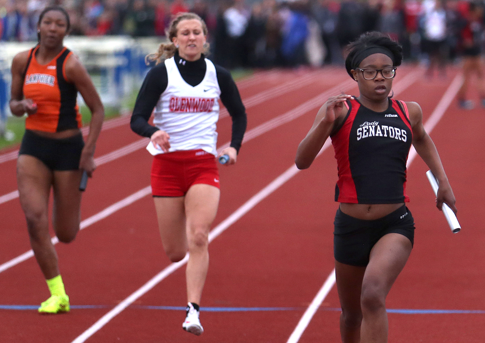 Springfield won the girls 4 x 100 meter relay event. in 50.59.   Ingrid Samuels at right ran the final leg and crosses the finish line at the end of the race. David Spencer/The State Journal-Register