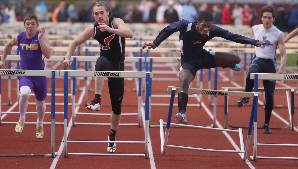 Xaviaer DuRousseau at right clips the final hurdle in route to winning the boys 110 meter hurdles event in 16:25. David Spencer/The State Journal-Register
