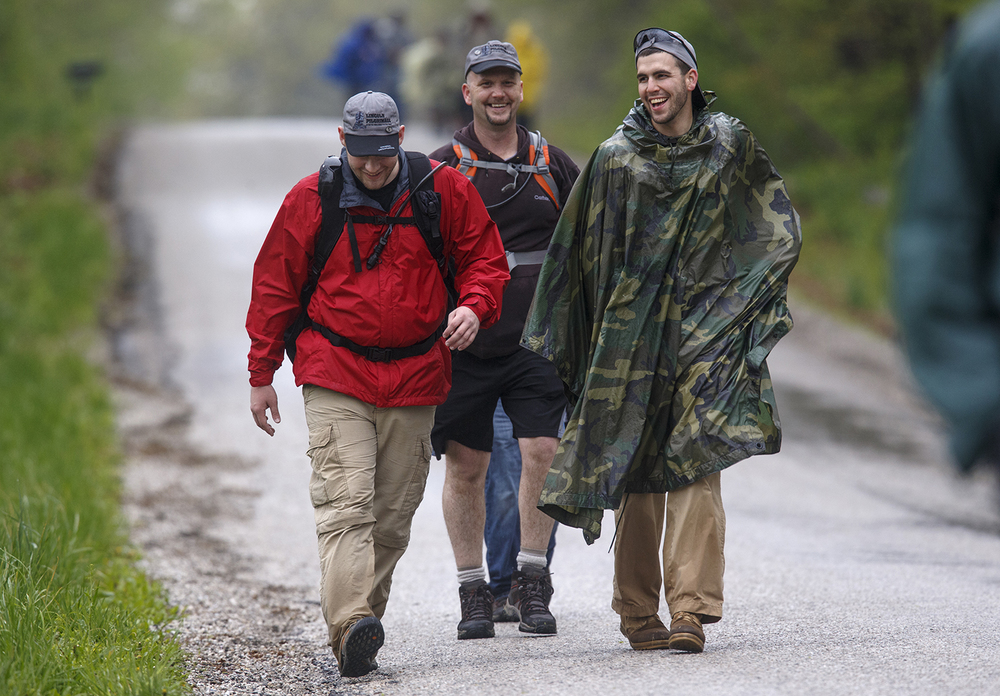 Justin Snyder, left, Jeremy Hayes and Stephen Engles of Brazil, IN, laugh together as they walk in the annual Lincoln Trail Hike Saturday, April 25, 2015. The trail between New Salem State Historic Site in Petersburg and Stuart Park in Springfield is the first historic trail recognized by the National Council of the Boy Scouts of America. Ted Schurter/The State Journal-Register