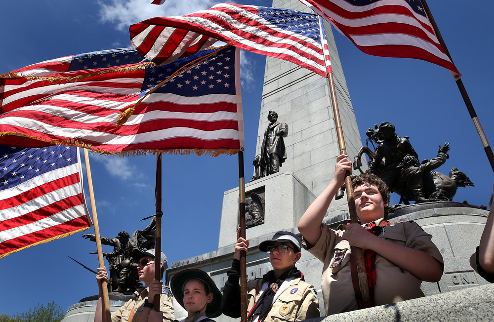 Gabe Schemmel, a member of troop 243 in Whitewater, WI at far right, was one of many flag-bearers stationed atop the Lincoln Tomb Sunday afternoon for the ceremony. David Spencer/The State Journal-Register