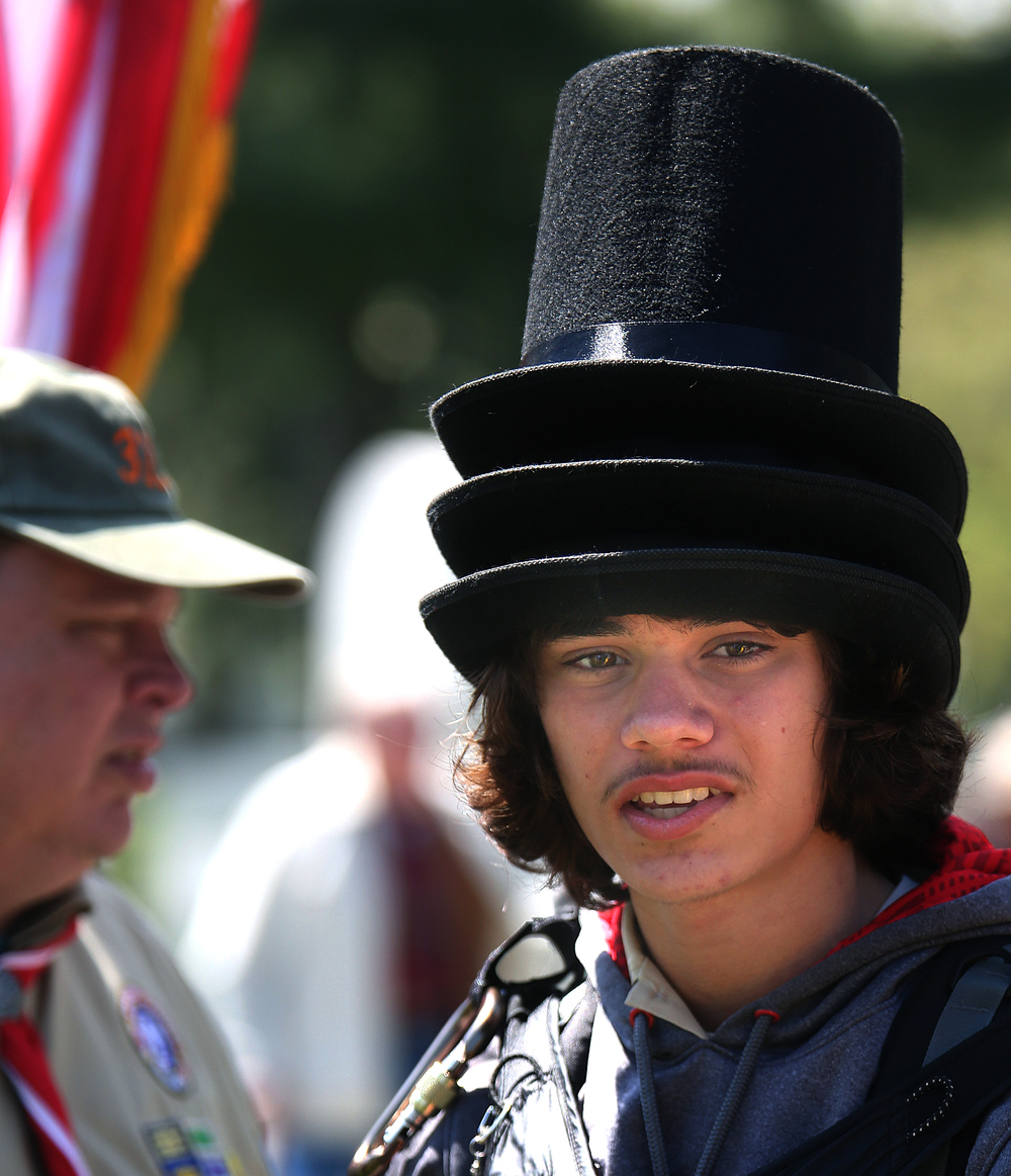 Troop guide John Gordon, 15, a boy scout from St. Louis, MO, sported three Lincoln stovepipe hats at the Sunday afternoon ceremony.David Spencer/The State Journal-Register