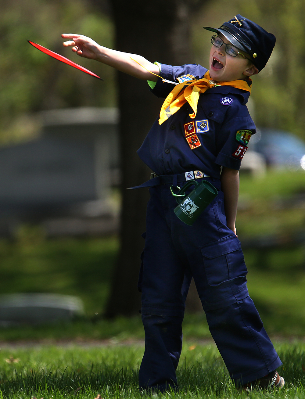Cub scout Braydon Steelman, a member of pack 53 from Hamel, Ill, has fun throwing a frisbee before the start of the Sunday ceremony. David Spencer/The State Journal-Register