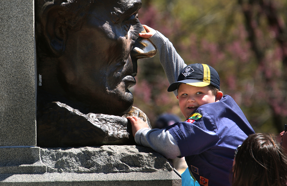 The traditional rubbing of Abraham Lincoln's nose for good luck on the large bronze bust of the former president in front of the tomb was accomplished by Bryson Tabor, a member of pack 262 from Salem, Ill. David Spencer/The State Journal-Register