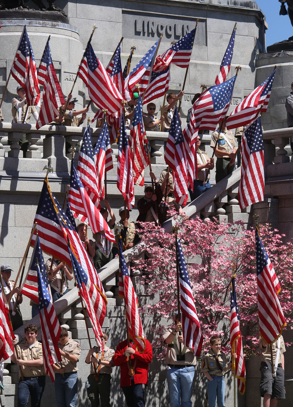 Boy scouts bearing U.S. flags provide the backdrop for the Sunday afternoon ceremony at the tomb. David Spencer/The State Journal-Register