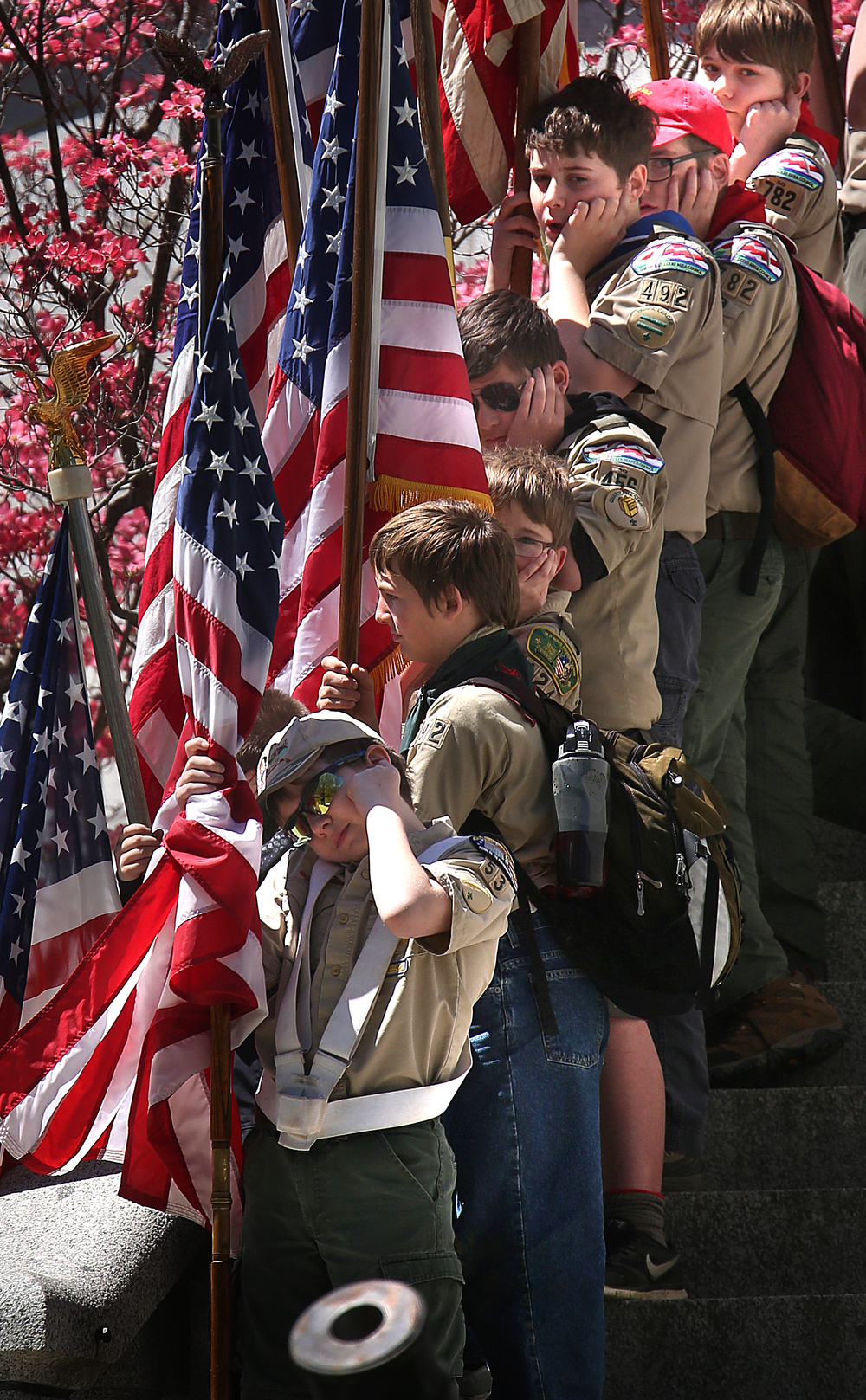 Boy scouts bearing flags on stairs of the tomb protect their ears moments before a cannon salute was given by members of the 114th Illinois Volunteer Infantry. David Spencer/The State Journal-Register